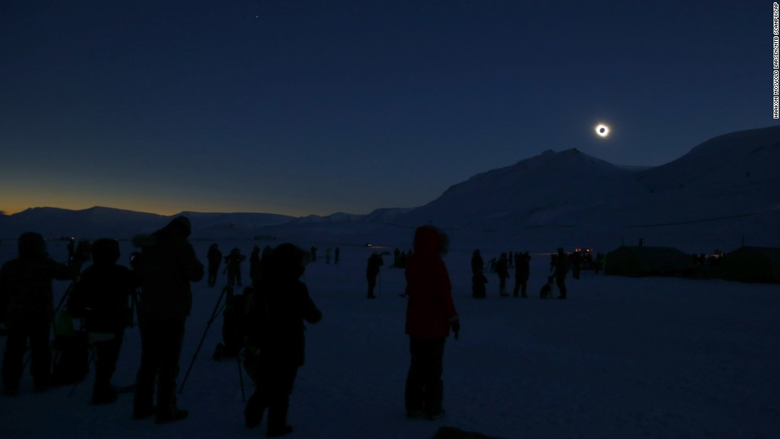 People view the total solar eclipse in Svalbard, Norway.