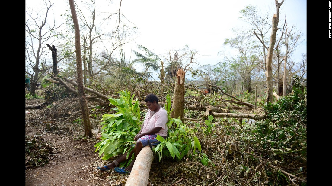 "A woman sits on a fallen tree among what's left of her garden in Port Vila, Vanuatu, on Thursday, March 19, nearly a week after Cyclone Pam ripped through the island nation in the South Pacific. <a href=""http://www.cnn.com/2015/03/17/asia/cyclone-pam-vanuatu/"">Vanuatu President Baldwin Lonsdale has called the storm a ""monster,""</a> saying it has set back the development of his country, already one of the poorest in the region, by years."