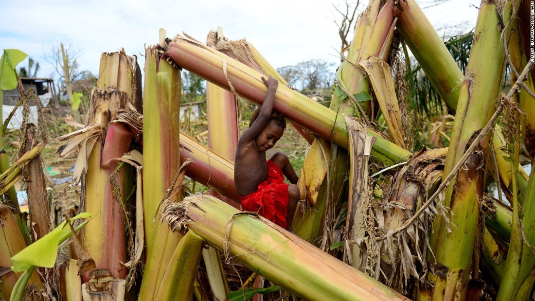 A young boy plays on a destroyed banana plantation in Mele, Vanuatu, on March 19.