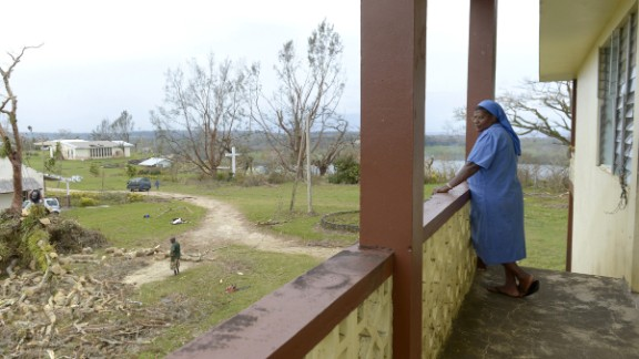 A nun surveys the damage near Port Vila on March 19.