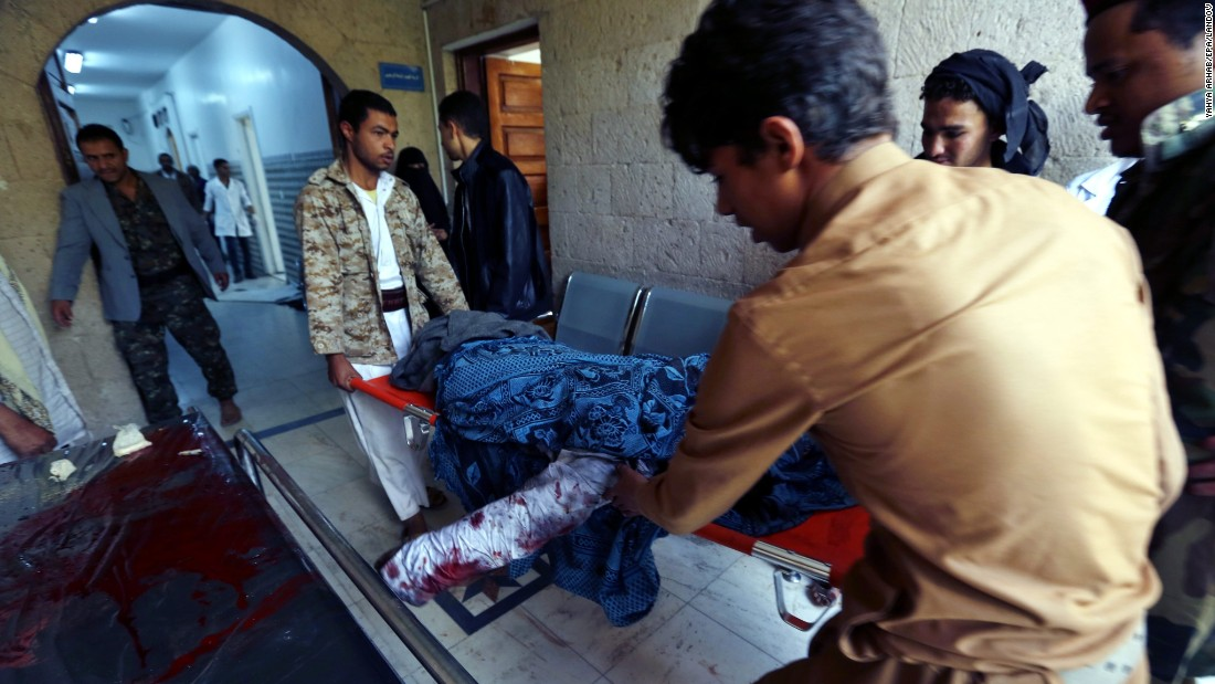 The body of a person killed in the attacks is carried to a hospital in Sanaa on March 20.