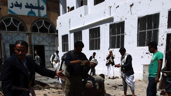 Yemeni security forces and Shiite Huthi militiamen remove charred bodies from the site of a bomb explosion at the Badr mosque in southern Sanaa on March 20, 2015. Triple suicide bombings killed at least 55 people at mosques in the Yemeni capital attended by Shiite Huthi militiamen who have seized control of the city. AFP PHOTO / MOHAMMED HUWAIS (Photo credit should read MOHAMMED HUWAIS/AFP/Getty Images)
