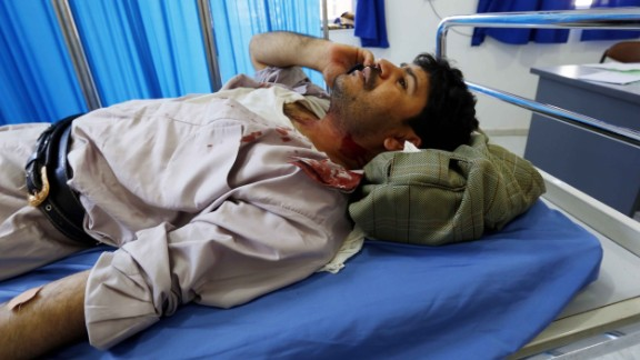 A wounded man lies on a bed at a hospital after the bombings in Sanaa on March  20.
