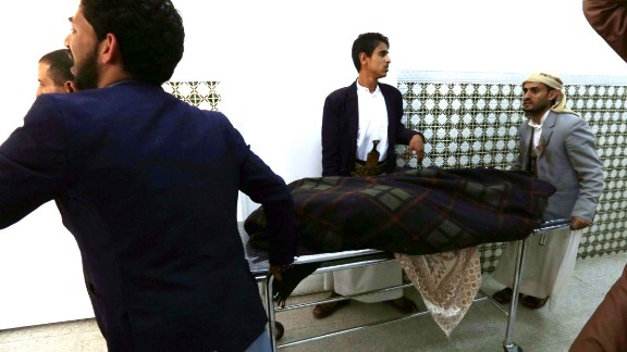 A casualty is wheeled to a hospital after the bombing attacks in Sanaa on March  20.