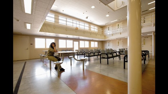 """A 16-year-old girl, identified only by the initials E.B., sits inside a juvenile detention center. """"I've been here 17 times,"""" she says in Richard Ross' latest collection of images, <a href=""""http://www.juvenile-in-justice.com/girls-in-justice"""" target=""""_blank"""" target=""""_blank"""">""""Girls in Justice.""""</a> In addition to showing the ugliness of life behind bars, Ross gives each girl a chance to talk about themselves and how they got where they are."""