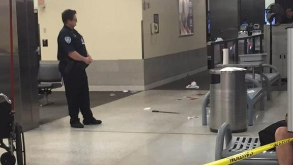 The machete allegedly used against TSA officers is seen on the floor of the airport.