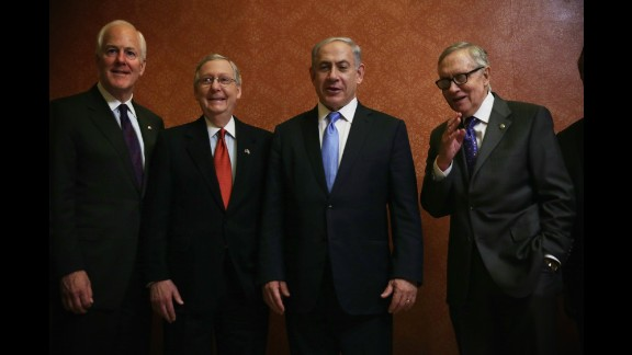 Senate Majority Whip John Cornyn, left, McConnell, Israeli Prime Minister Benjamin Netanyahu, and Senate Minority Leader Sen. Harry Reid, D-Nevada, pose for photos at the U.S. Capitol in Washington on March 3, the day of Netanyahu's controversial speaking engagement before a joint session of Congress.