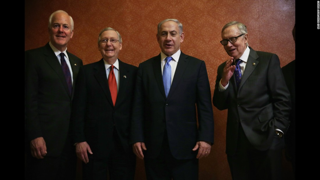 "Senate Majority Whip John Cornyn, left, McConnell, Israeli Prime Minister Benjamin Netanyahu, and Senate Minority Leader Sen. Harry Reid, D-Nevada, pose for photos at the U.S. Capitol in Washington on March 3, the day of <a href=""http://www.cnn.com/2015/03/02/politics/netanyahu-speech-iran-obama-congress/"">Netanyahu's controversial speaking engagement</a> before a joint session of Congress."