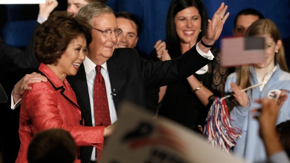McConnell and Chao wave to supporters at a victory celebration following McConnell's victory in the Republican senatorial primary on May 20, 2014, in Louisville, Kentucky.