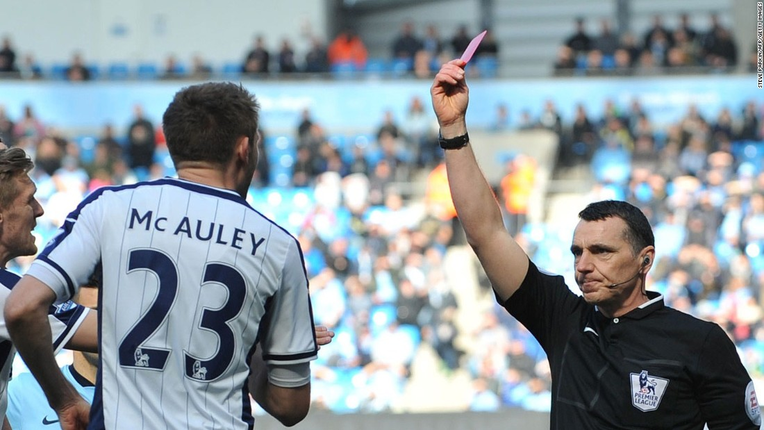Referee Neil Swarbrick dismisses Gareth McAuley of West Bromwich Albion during Saturday's EPL match with Manchester City.
