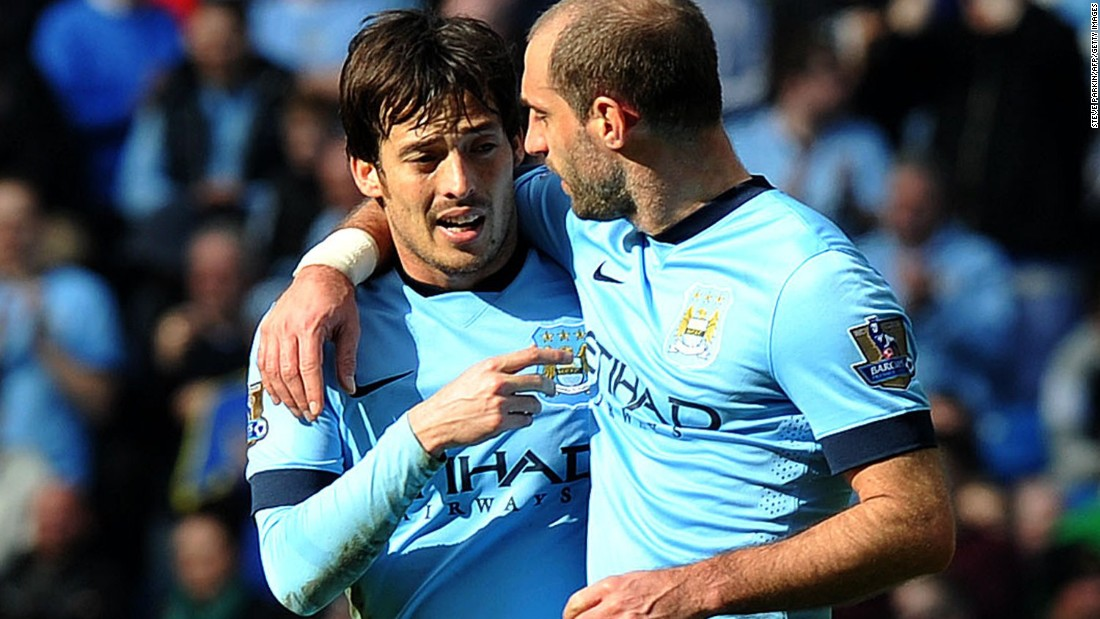 David Silva (left) celebrates with teammate Pablo Zabaleta after making it 3-0 to City late in the second half.