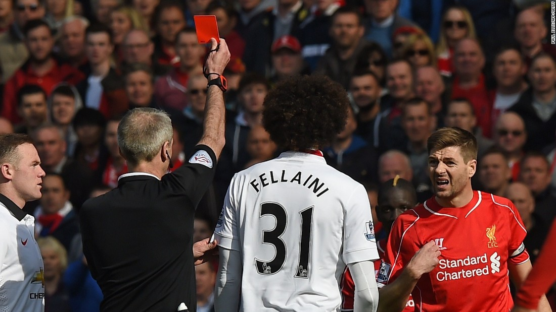 Steven Gerrard is shown a red card by referee Martin Atkinson for his stamp on Ander Herrera.