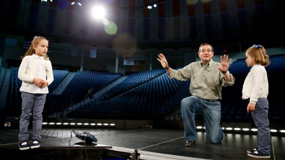 Cruz brings his daughters Caroline, left, and Catherine on stage during a walk-through Sunday, March 22, at Liberty University in Lynchburg, Virginia.