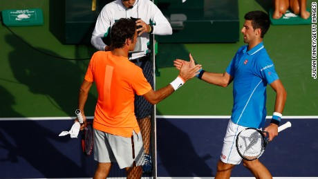 For the second year in a row, Novak Djokovic, right, beat Roger Federer in three sets in the Indian Wells tennis final.