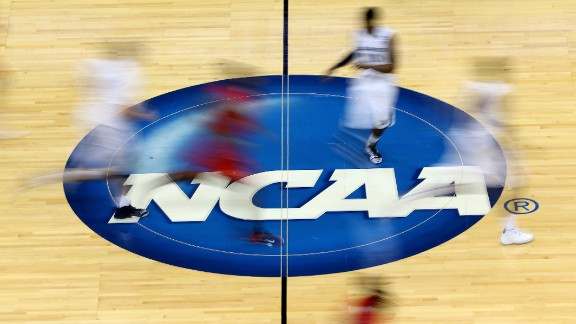 JACKSONVILLE, FL - MARCH 19:  Mississippi Rebels and Xavier Musketeers players run by the logo at mid-court during the second round of the 2015 NCAA Men
