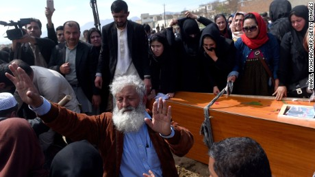 Independent Afghan civil society activist women and Afghan men lower the coffin of Afghan woman Farkhunda, 27, who was lynched by an angry mob, at the cemetary in central Kabul on March 22, 2015.  Hundreds of people on March 22, attended the burial of an Afghan woman who was beaten to death and set on fire by a mob for allegedly burning a copy of the Koran.  The body of Farkhunda, 27, who was lynched on March 19 by an angry mob in central Kabul, was carried to the graveyard by women amid crowds of men, an AFP reporter said, a rare act of protest in a male-dominated society.   AFP PHOTO / Wakil Kohsar        (Photo credit should read WAKIL KOHSAR/AFP/Getty Images)