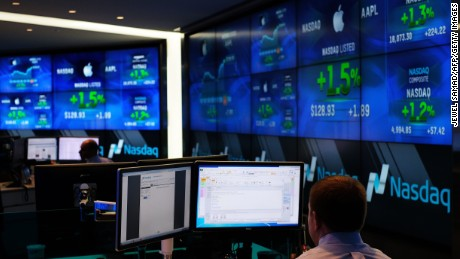 Traders work at the Nasdaq MarketSite in New York on March 18, 2015.