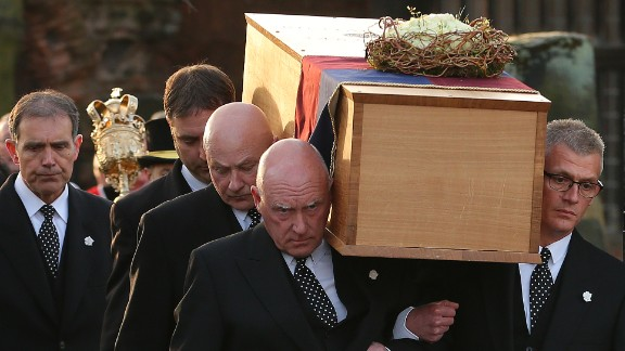 Pallbearers carry the coffin during the procession on March 22.