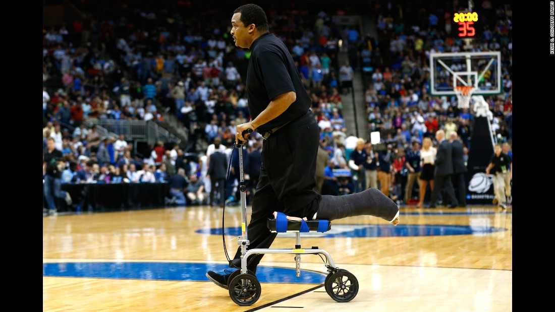 "Georgia State head coach Ron Hunter wheels off the court after the first half of an NCAA Tournament game Saturday, March 21, in Jacksonville, Florida. Hunter tore his Achilles tendon earlier this month while celebrating his team's win in the Sun Belt Conference tournament. He nearly hurt himself again when <a href=""http://bleacherreport.com/articles/2402692-georgia-states-rj-hunter-hits-game-winning-3-coach-falls-out-of-chair"" target=""_blank"">he fell off a rolling stool</a> during his team's upset victory over Baylor."