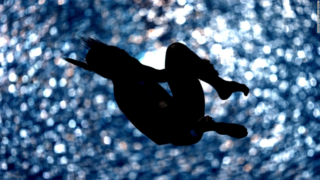 Malaysian diver Pandelela Rinong tucks her body as she competes in the 10-meter platform Saturday, March 21, during a Diving World Series event in Dubai, United Arab Emirates.