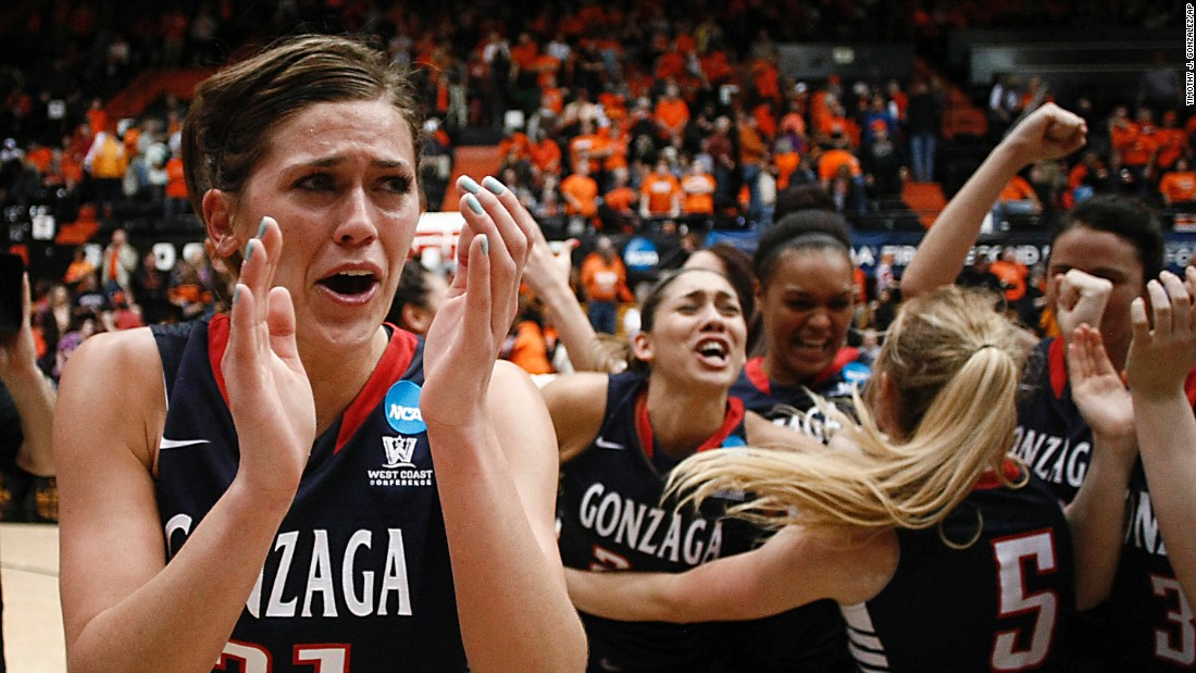Elle Tinkle, left, and her Gonzaga teammates celebrate their second-round victory over Oregon State in the NCAA Tournament on Sunday, March 22. Tinkle's father, Wayne, is the coach of Oregon State.