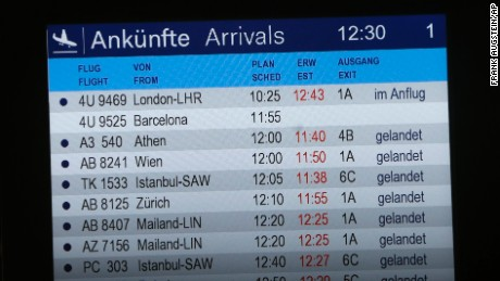 The arrivals board shows Flight 4U 9525 without a status at the airport in Duesseldorf on March 24.