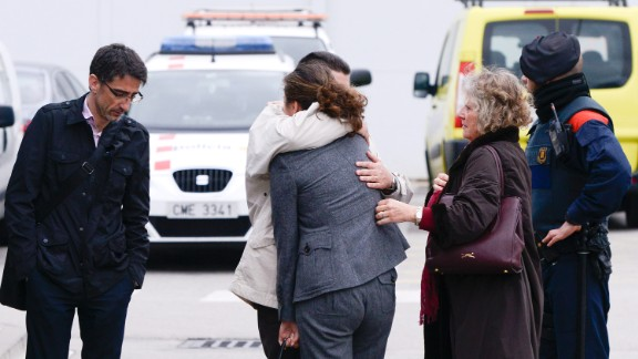 Relatives of the flight's passengers arrive at the airport in Barcelona on March 24.