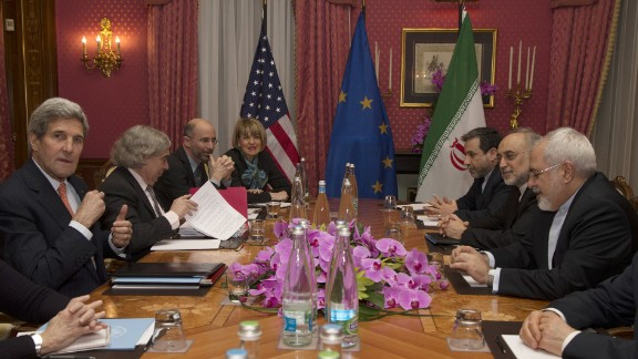 United States Secretary of State John Kerry (L) sits with his delegation during a negotiation meeting concerning Iran