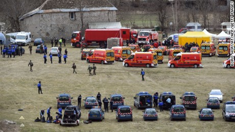 Emergency workers and members of the French Gendarmerie gather on March 24 in Seyne, France, near the site where the plane crashed.