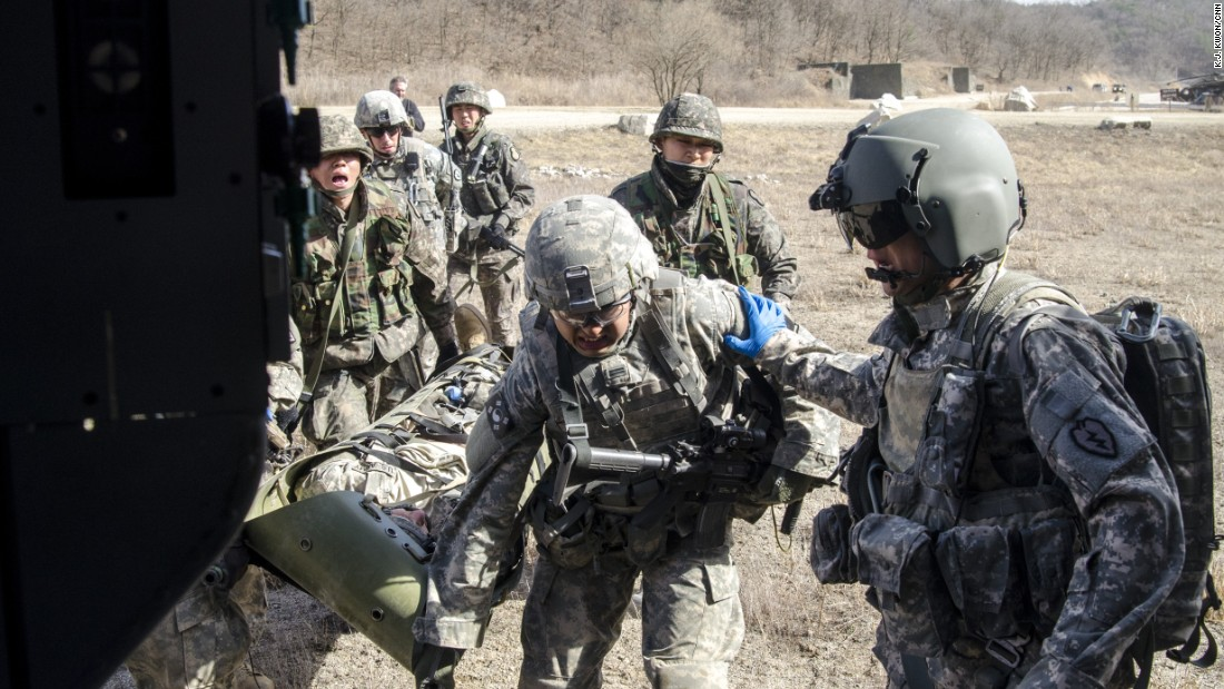 U.S. and South Korean soldiers carry an injured soldier to a helicopter as part of the joint military exercise.