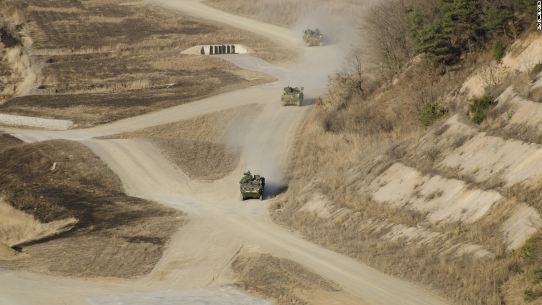 South Korean Army armored vehicles move at speed during the military maneuvers.