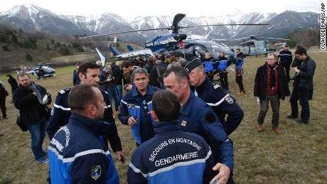 Rescue workers and members of the French Gendarmerie gather in Seyne, France, on Tuesday, March 24, as search-and-rescue teams struggle to reach the remote crash site of Germanwings Flight 9525.