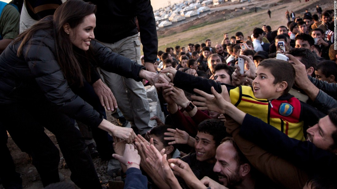 Angelina Jolie meets members of the Yazidi minority at a refugee camp in Khanke, Iraq, in January 2015.
