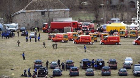 Caption:French emergency services workers (back) and members of the French gendarmerie gather in Seyne, south-eastern France, on March 24, 2015, near the site where a Germanwings Airbus A320 crashed in the French Alps. A German airliner crashed near a ski resort in the French Alps on March 24, killing all 150 people on board, in the worst plane disaster in mainland France in four decades. AFP PHOTO / BORIS HORVAT (Photo credit should read BORIS HORVAT/AFP/Getty Images)