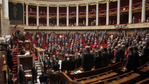 French parliament members observe a minute of silence at the National Assembly in Paris on March 24.