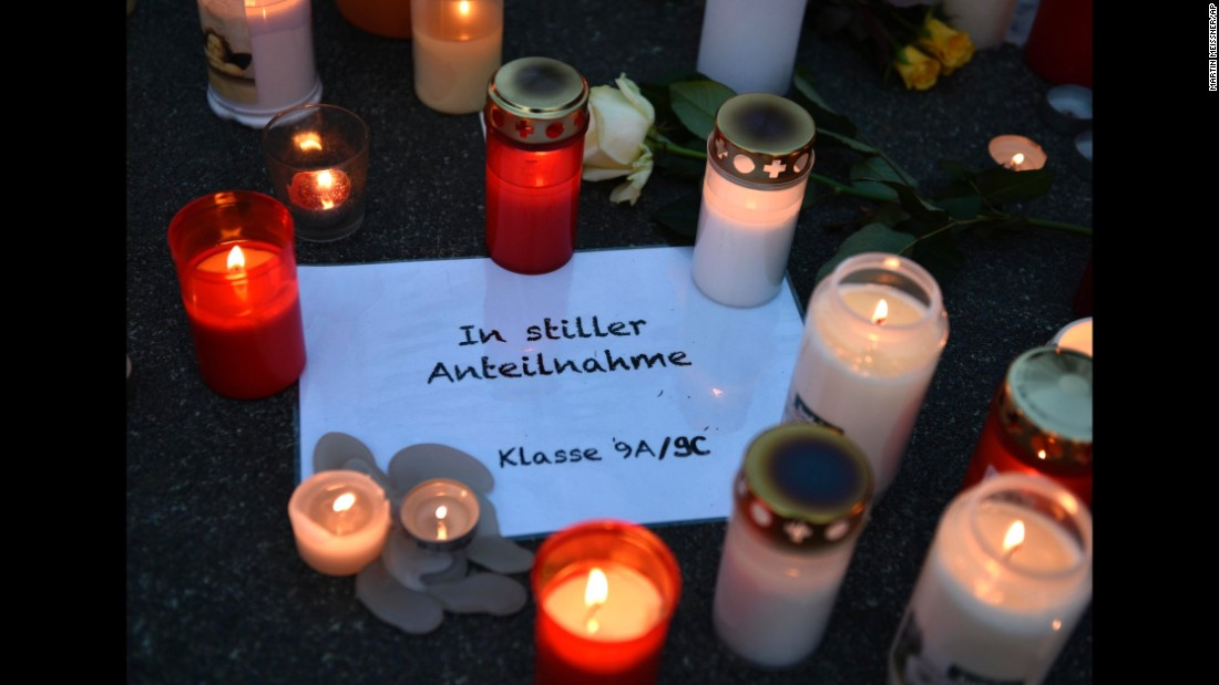 "Candles sit on a paper reading ""In silent memory, Class 9A/9C"" in front of the Haltern high school on March 24."