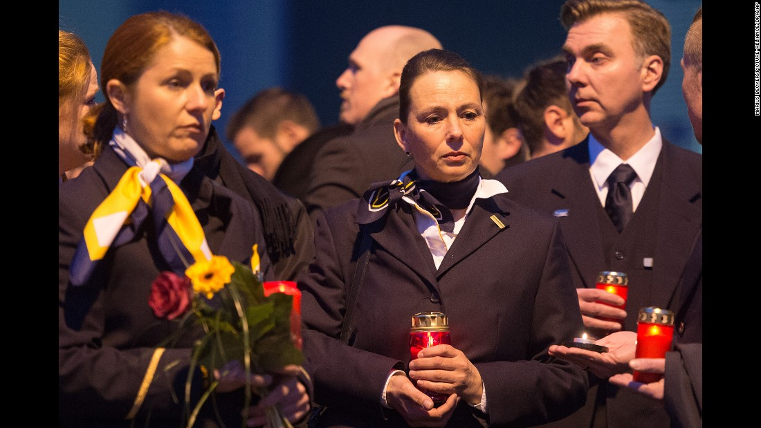 Staff members of Germanwings and Lufthansa stand in front of the Germanwings headquarters in Cologne, Germany, on March 24. They placed flowers and candles at the main entrance. Germanwings is a low-cost airline owned by the Lufthansa Group.
