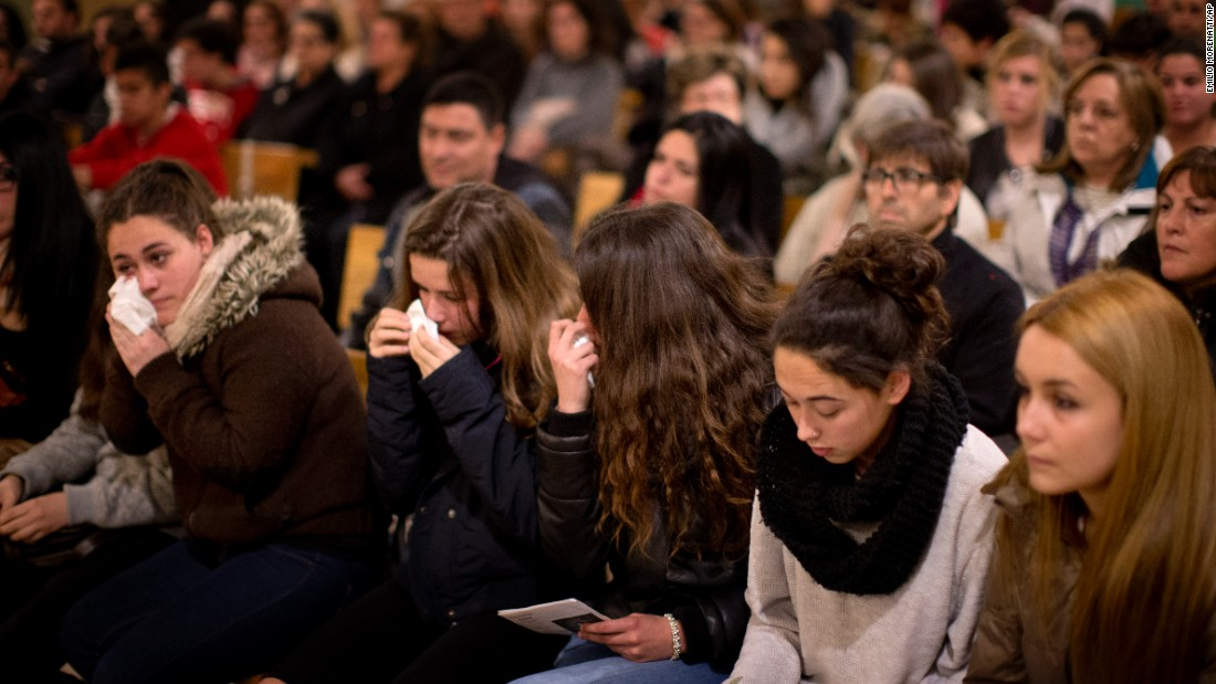 Friends of the German students attend a Mass in Llinars del Valles, a Spanish village near Barcelona, on March 24.