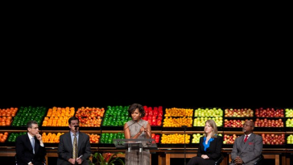 Through the initiative, millions of kids are attending healthier day care centers, where fruits and vegetables have replaced cookies and juice. Michelle Obama speaks at a Let