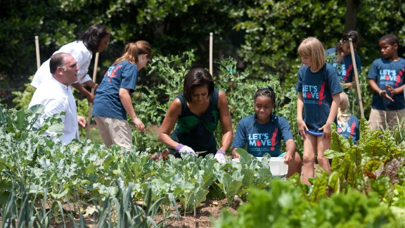 First lady says she is committed to giving kids the healthy futures they deserve. Here she works with chefs and students in the White House Kitchen Garden on the South Lawn in 2010.
