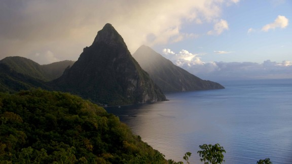 "Saint Lucia stretches 27 miles long in the Caribbean Sea. iReporter Dennis Licht enjoyed ""the gorgeous scenery, the lush vegetation and watching the storms roll over the Pitons, as this picture illustrates."""