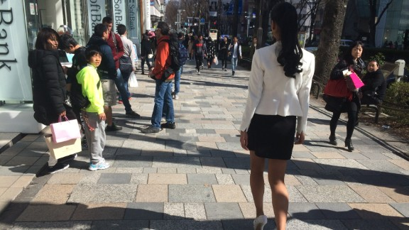 Ariana Miyamoto, 20, attracts stares, picture takers, and curiosity as the newly crowned Miss Universe Japan walks the streets of Tokyo's fashionable Harajuku district.