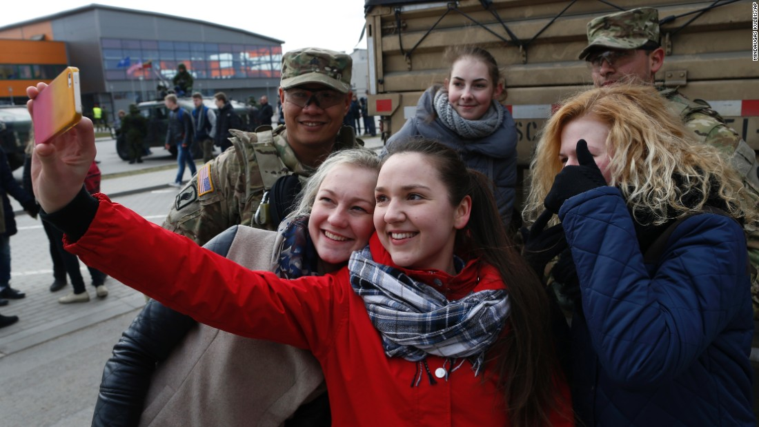 A girl takes a selfie with members of the 2nd Cavalry Regiment in Salociai on March 23.