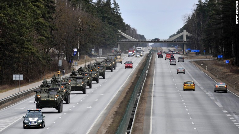 Stryker vehicles make their way down a highway in Riga, Latvia, on Sunday, March 22. The convoy is unusual because long-distance movement of heavy military vehicles such as the 18-ton Strykers is usually done by rail.