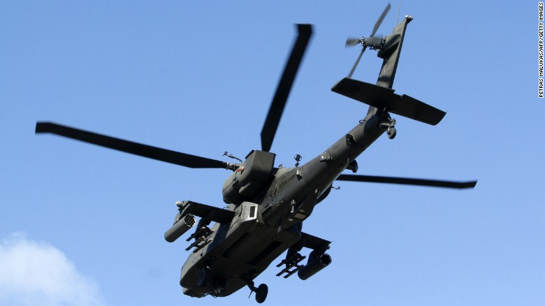 A U.S. military helicopter accompanies the convoy as it arrives in Vilnius on March 22.