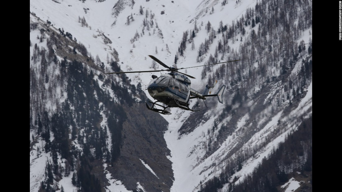 A helicopter comes in to land near Seyne-les-Alpes, the staging ground for search efforts, on March 25.