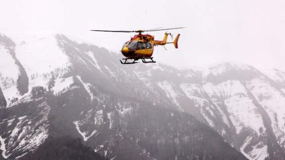 Gendarmerie and French mountain rescue teams arrive near the site of the Germanwings plane crash near the French Alps on March 24, 2015