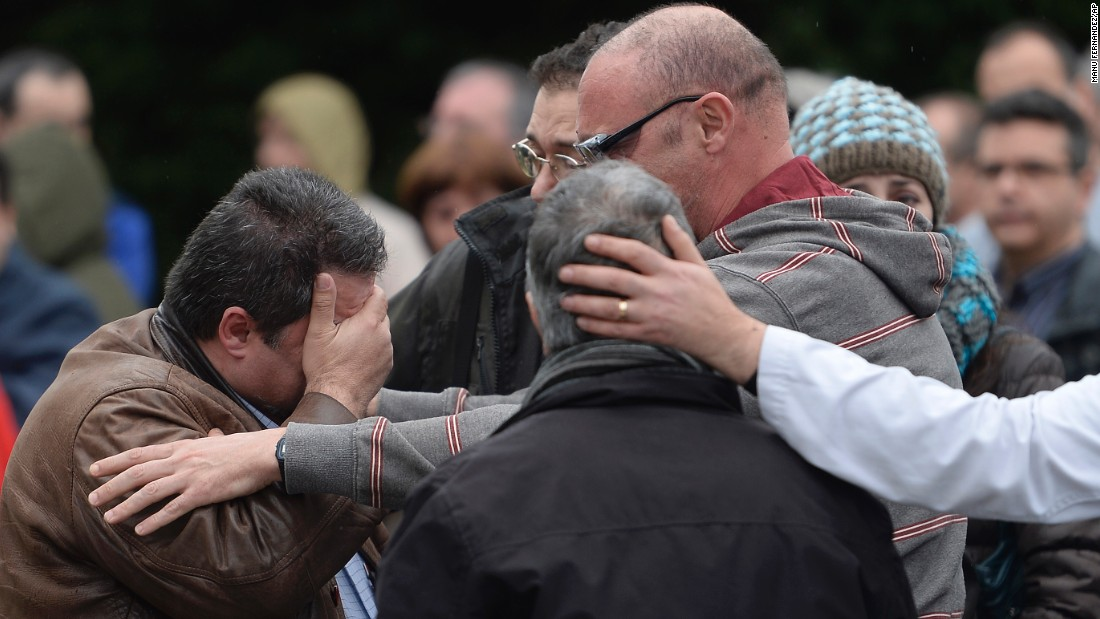 Workers from the Delphi factory, who lost two colleagues in the crash, mourn together in Sant Cugat del Valles, Spain, on March 25.