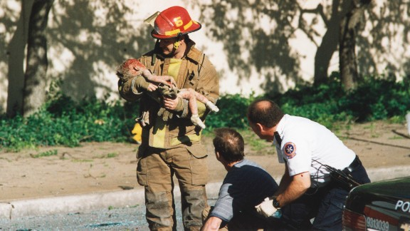 Oklahoma City firefighter Chris Fields holds a baby who was inside the Alfred P. Murrah Federal Building when it was hit by a truck bomb on April 19, 1995. The 1-year-old, Angel Baylee Almon, later died in the hospital. She was one of the 168 people killed in the terrorist attack. More than 500 people were injured.