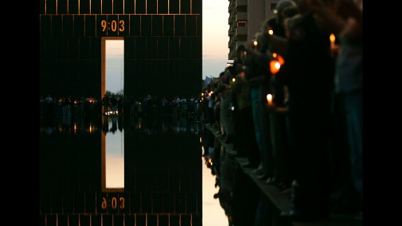 Ten years after the attack, a candlelight vigil is held at the Oklahoma City National Memorial.